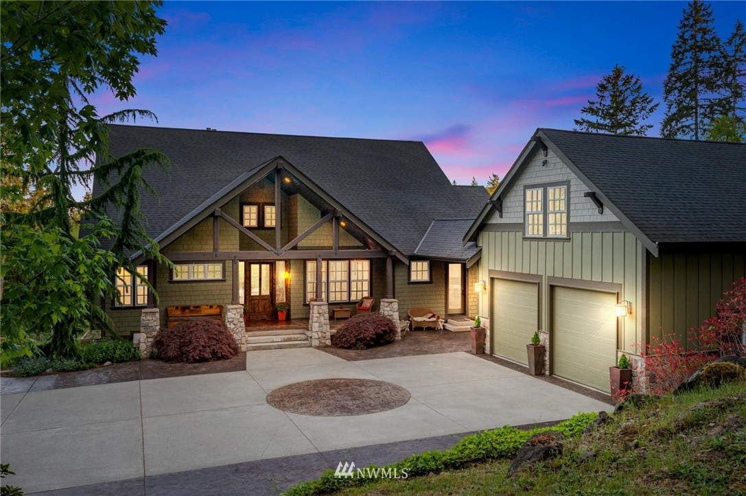 Escape the world's chaos to your breathtaking menagerie of serene rolling pastures, venerable views, and extraordinary Craftsman sanctuary. 7.1 fully fenced/usable acres, views of Glen Cove, Mt. Adams, & Mt. Rainier are the glorious backdrop for the 4630 sf 4 bd/3.5 bath home boasting exquisite detail. A solid walnut door opens to 24 ft beamed ceilings, 3 stone fireplaces, and over 1200 sf of stamped concrete covered outdoor entertaining space.  The main floor master is truly a haven, with dual walk ins, full steam sauna in the bath, and deck access. Phenomenal kitchen too! Gorgeous solar powered Barn with loft, detached Shop, multiple outbuildings, Gardens, parking galore, Riding Trail access.  A rare, magical retreat!