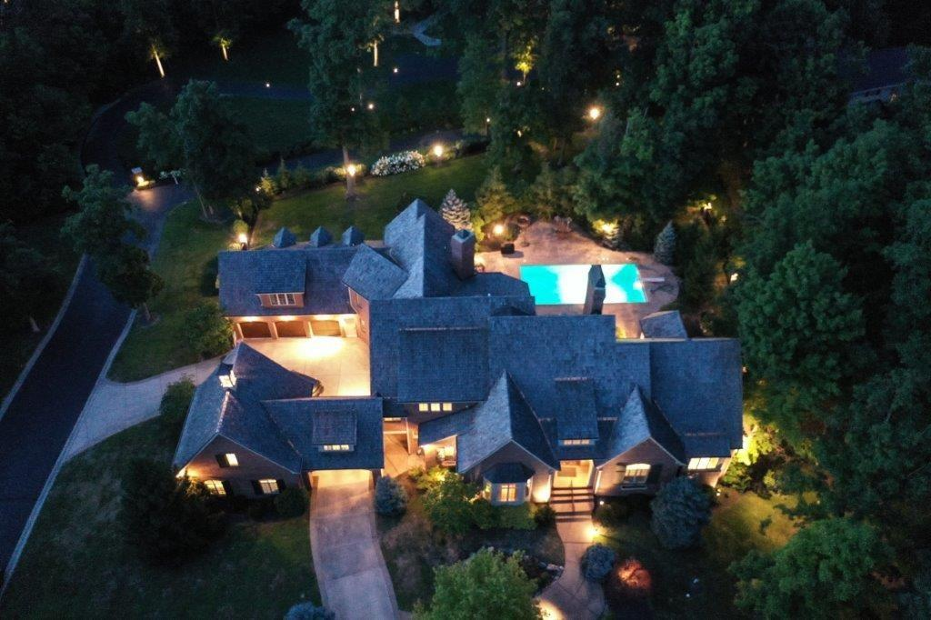 Exclusive Opportunity To Own This Amazing Estate in Private, Gated Geist WATERFRONT Community. Nestled on 1.7+Wooded AC w/Deeded BOAT DOCK. This Spectacular Home Features over 12,000+SF of High-End Finishes, Extensive Millwork, Newer Cedar Shake Roof, 6 FP, 10'-14' Ceilings, MAIN LVL Owner's Wing w/BD Suite, Sitting RM & Library. Upper Level w/3 Additional Generously Sized Suites & 2nd Office. Custom Kitchen w/High End Appl, Breakfast RM, Butler's Pantry & WI Pantry. Main Level Office, Dining RM & Hearth RM. Exceptional LL w/Daylight Windows, Rec Area, 5th BD Suite, Full BA, Wine Cellar, Fitness RM, Full Kitchen/Wet Bar, & Theatre RM. Private Outdoor Living w/Covered Porch, Gunite Pool, Hot Tub & B-ball Court. Generous 3CATC & 2CDTC Garage.