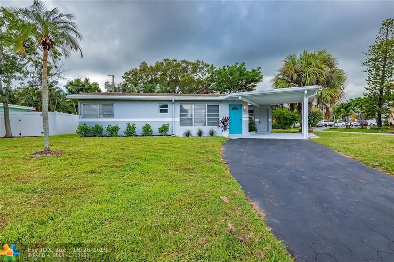 Amazing opportunity in prestigious area of The Cove/Deerfield Beach, this beautiful 3 bedroom 2 bath home is less than a mile to the beach. Perfect corner lot for a family or as a rental/Airbnb investment, with large yard, carport and extra shed. Home is ready to move in showing beautiful upgrades, such as new a/c, newer roof, an accent shiplap wall in living area, white wood soft closing cabinets, quartz counters, SS appliances, waterproof flooring, modern fixtures, fresh paint, fresh landscaping and much more.  Minutes to restaurants, shops, pier, 10th St (& all highways), and walking distance to Target. Priced 100K below the lowest listing in the area. Don't miss this great opportunity! Bring your boat and enjoy the Florida East living life style!