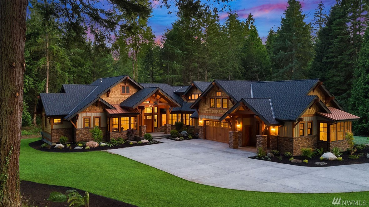 A Taste of Telluride in Wine Country! Inspired by the grand luxury lodges of the most esteemed 5-Star destinations, Luxury Builder, Grant Franklin Homes, designed this nearly 6000 sq ft estate for the most exacting buyer. Every carefully selected, quality detail is meticulously crafted, from the wide plank floors to the rich, ledge stone accents and stunning custom lighting. Soaring, open beam architecture, walls of windows, outdoor living area, wine cellar, shop. Prime Woodinville location!