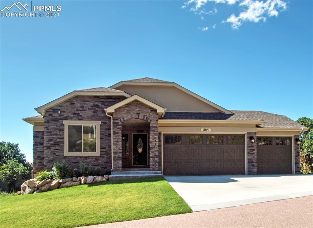 This ranch style home is better than new with stunning mountain views & a large usable backyard (property was completed in 2018 not 2016 when the assessor shows).  Located in the Star Ranch gated community this home has 5 bedrooms, 3 baths, 3 car garage, front & back professional landscaping, & fully finished walkout basement. Enjoy the covered front entrance as you walk up to the front door. Main level has three bedrooms, hardwood flooring, vaulted ceilings, gourmet kitchen with counter bar, main level laundry, views, & walkout to the deck from the main level Living room. Kitchen features quartz countertops, stainless steel high-end Kitchen-aid appliances, gas range, & pantry. Living /dining room combo with stone surround gas fireplace. Master bedroom is on main level & features vaulted ceilings with an adjoining 5 piece bath & walk-in closet. Master bath has tile flooring, tile surround, soaking tub, double vanity, & a large shower. Oversized family room in the lower level has a wet bar with a refrigerator, custom tile backsplash, built-in wine rack, & plenty of cabinetry for extra storage. Main level has three bedrooms with two bathrooms, great floorplan for main level living. Both lower level bedrooms are good sized & one features a walk-in closet. Enjoy having a walk-out basement with the convenience of walking out to the concrete patio & fully landscaped backyard with ample amount of yard space. Updates include: Plantation shutters, oversized lot with views, AC, windows coverings, wet bar, custom finishes, ceiling fans, three car bay, stucco & stone exterior, & radon mitigation system. Located in desirable D-12 schools, close to trails, schools, parks, I25, shopping, & historic Broadmoor Hotel, Zoo, Cheyenne State Park, bases, & HWY 24 that leads to the ski resorts.  This one is truly move in ready & looks like a brand new home!