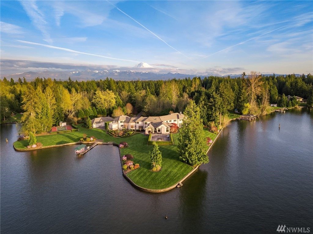 Awe-inspiring Snag Island estate with unparalleled grandeur, 5.23 acres & 1,370' of waterfront! Timeless finishes throughout the home with incredible entertaining spaces, fresh hardwood floors & paint. Awesome floor plan with main floor formal living & dining rooms, den/game room, theater, exercise, sun-room, wine cellar & fantastic updated kitchen & family room open to outdoor patio with pool, sport court & awesome beach with dock. Amazing apartment & 7+ car garage! Welcome to your dream home!