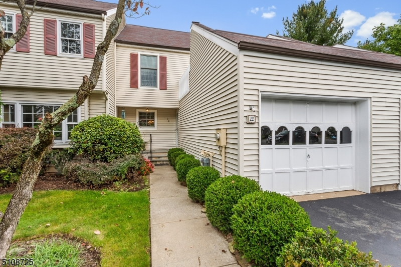 This desirable Chelmsford model townhome is in the sought-after neighborhood of Mendham Commons, located convenient to shopping, schools, and commuting highways and public transportation. The interior includes a floor plan that flows well for day-to-day living. The first floor features a large living room, dining room and eat-in kitchen with plentiful storage.  The open LR/DR have gleaming wood floors, a gas fireplace and large sliding glass doors which provide natural light and easy access to the lush rear patio. Upstairs there are two large bedrooms and a full hall bathroom. The primary bedroom has two lighted, large closets and an en suite bathroom with stall shower. The 2nd bedroom has plenty of natural light along with two large closets and access to the personal outdoor balcony porch.  This gated community features amenities galore including a fitness room, indoor & outdoor pool, tennis courts, playground, clubhouse, and walking paths. All this just minutes to historic downtown Mendham and Morristown.