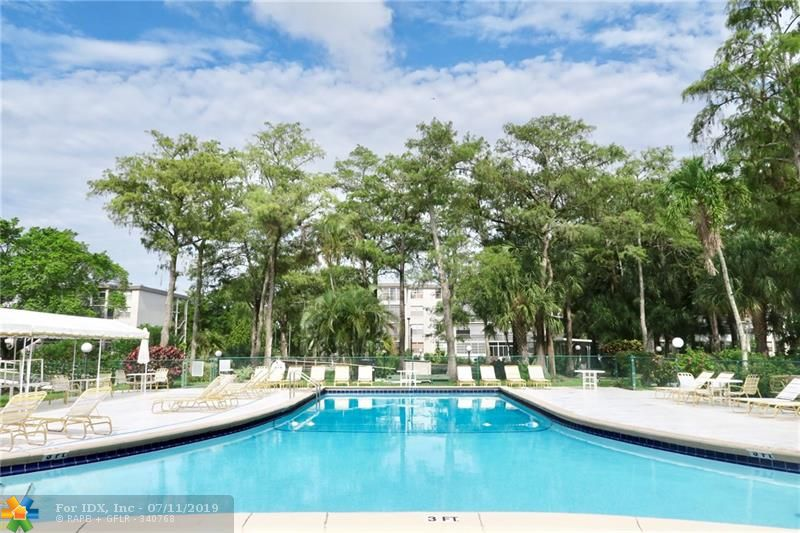Gorgeous 1/1 apartment, fully furnished, clean and Move-in ready! nice garden and canal views, Murphy bed in Florida room, all tile!  55+ community includes water, insurance, community pool, Petanque, shuffle board. Easy to show!