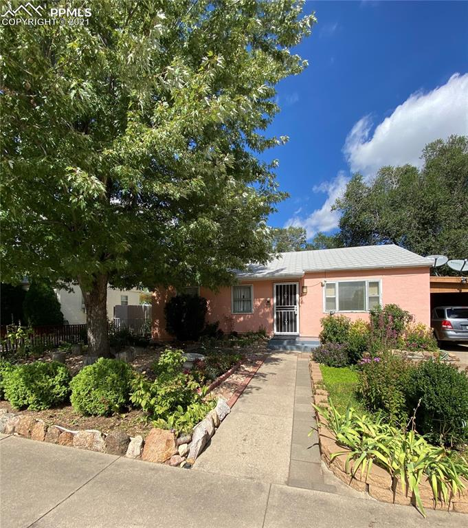 This Cozy Rancher can be a great starter home or investment. It has 2 bedrooms 1 bath with 1 oversized carport.  Large master bedroom. True main-level living. Fully landscaped yard with vegetable garden and fruit trees. All appliances included. Home is sold as is.