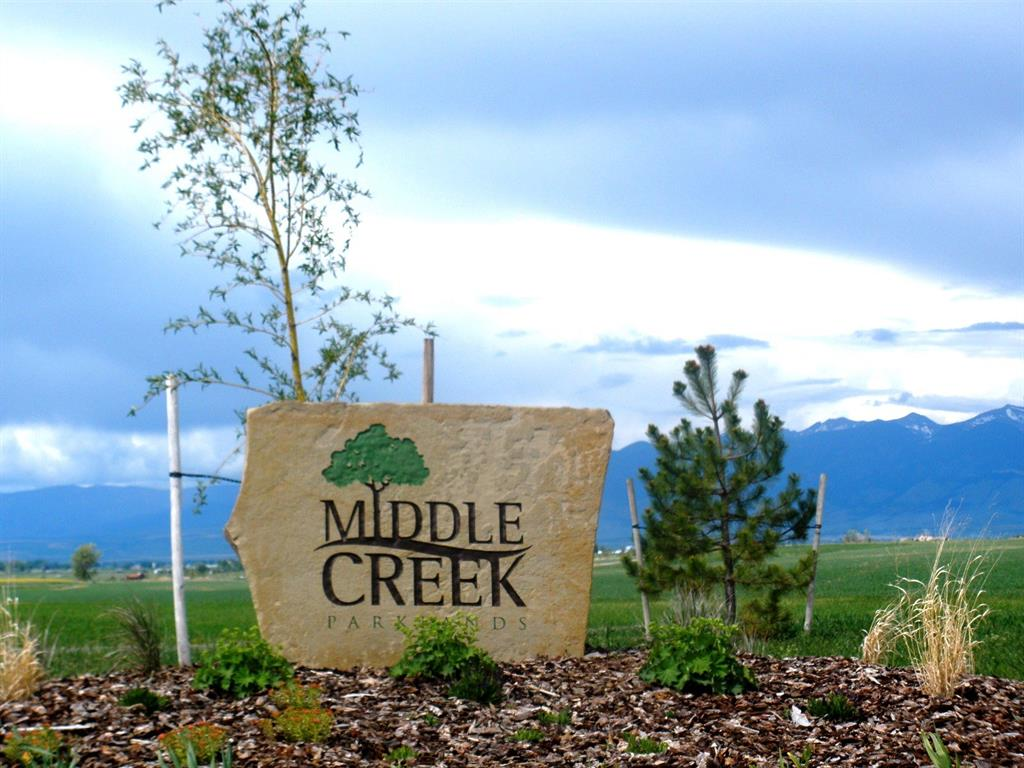 Large corner lot in Middle Creek Parklands.  Backs to park and walking trail. Mountain Views. Monforton School District.