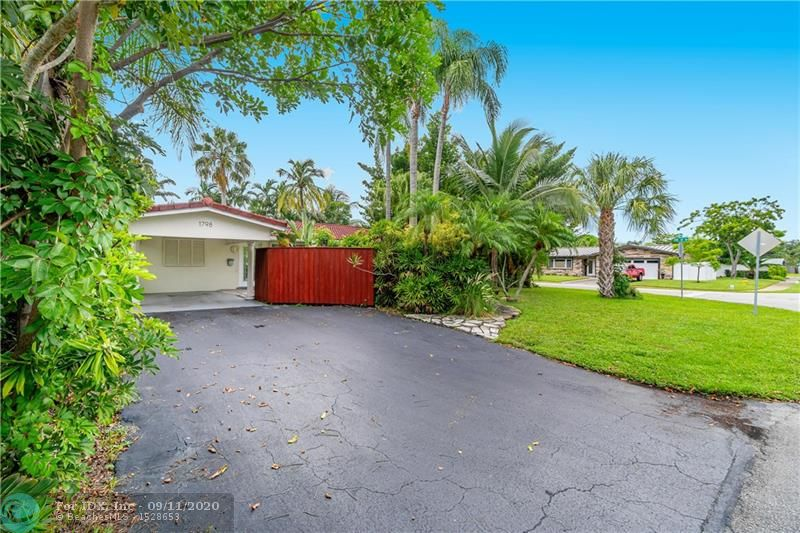 FANTASTIC OPPORTUNITY TO BUY IN THE GREAT NEIGHBORHOOD OF ROYAL PALM ISLES! THIS POOL HOME HAS 2 MASTER SUITES, ONE WITH MURPHY BED. HOME WAS ORIGINALLY A 3 BEDROOM HOWEVER ONE BEDROOM HAS BEEN CONVERTED INTO AN OPEN OFFICE/MEDIA ROOM AND IS EASILY CONVERTED BACK. SPLIT FLOOR PLAN. ACCORDION SHUTTERS AND BAHAMA STYLE SHUTTERS FOR FULL HOME PROTECTION. 2014 BARREL TILE ROOF. AC 2014 WITH STERILIZATION UV LIGHT TO KEEP YOUR AIR CLEAN. TILE IN MAIN LIVING AREA. BRAZILIAN HARD WOOD FLOORS IN MASTER & GUEST BEDROOM. FENCED IN YARD. 1 CAR CARPORT. VERY LOW TRAFFIC WITH THIS CUL-DE-SAC LOCATION SITUATED ON A CORNER LOT. LARGE POOL AND ADDITIONAL HOT TUB ON WOOD DECK. NEIGHBORHOOD PARKS INCLUDE ROYAL PALM PARK, EASTERLIN PARK ALONG WITH OAKLAND BARK DOG PARK AND NEWLY ADDED STUNSON NATURE TRAIL.