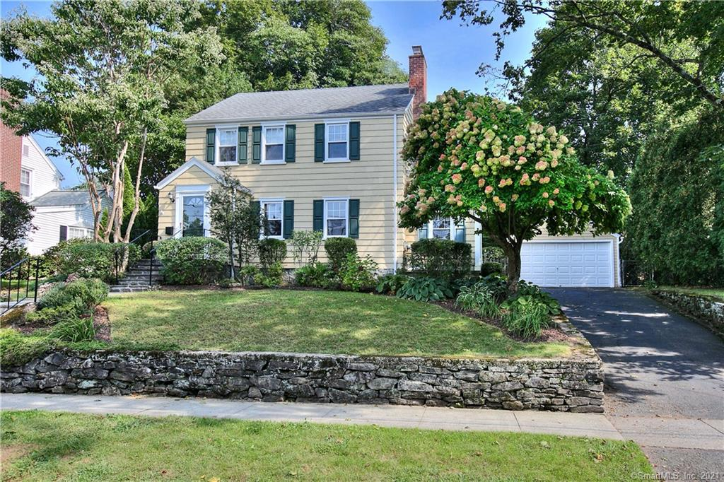 Quintessential New England Colonial - located on a lovely, tree lined Stratfield neighborhood street. Beautiful entry with blue stone walkway & stairs. Foyer w/ French Door opens to a formal Living Room w/ fireplace. Sunroom or Home Office alternative w/ access to rear patio is located off the Living Room. Sun-filled and spacious formal Dining Room. Renovated Kitchen with stainless appliances, custom cabinetry, honed granite counters, natural stone backsplash, updated fixtures and lighting. Half Bath and pantry/storage off Kitchen complete the first floor.  The second floor offers 3 good sized Bedrooms and an updated Full Bath. Walkup attic access. Partially finished lower level w/ builtins. Private, fabulous blue stone patio which spans the back of the house - great for entertaining and gatherings. Professionally landscaped, terraced yard filled with perennials and specimen plantings. Upper yard access via staircase behind garage to your very own horseshoe pit! Wrap yourself in the charm of a 1940s colonial with the amenities and upgrades for today's busy lifestyle. Take advantage of everything Fairfield CT has to offer: easy access to highways & NYC trains, town beaches, lakes, marina, downtown shopping, dining and award winning schools.