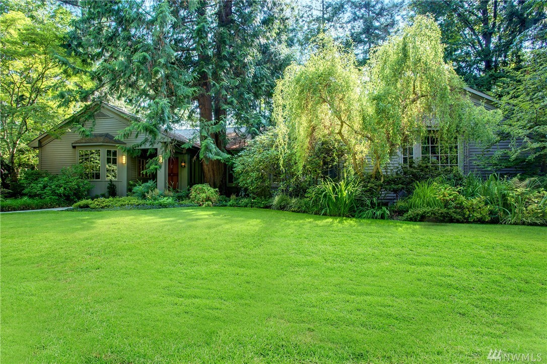 Rare,elegant residence in prime West Mercer locale. Evergreen Lane, an enchanted enclave of select homes in a park-like setting. Nearly 2 acre property adorned by a sweeping lawn, magnificent trees, split rail fence, & rich landscaping creates the setting. 1930's original home transformed & expanded by noted NW masters Bumgardner architect & Schultz Miller. Main floor level living of sophisticated scale, dramatic spaces, rich ambiance & character. Private outlook. Darling 1BR/1BTH guest house.