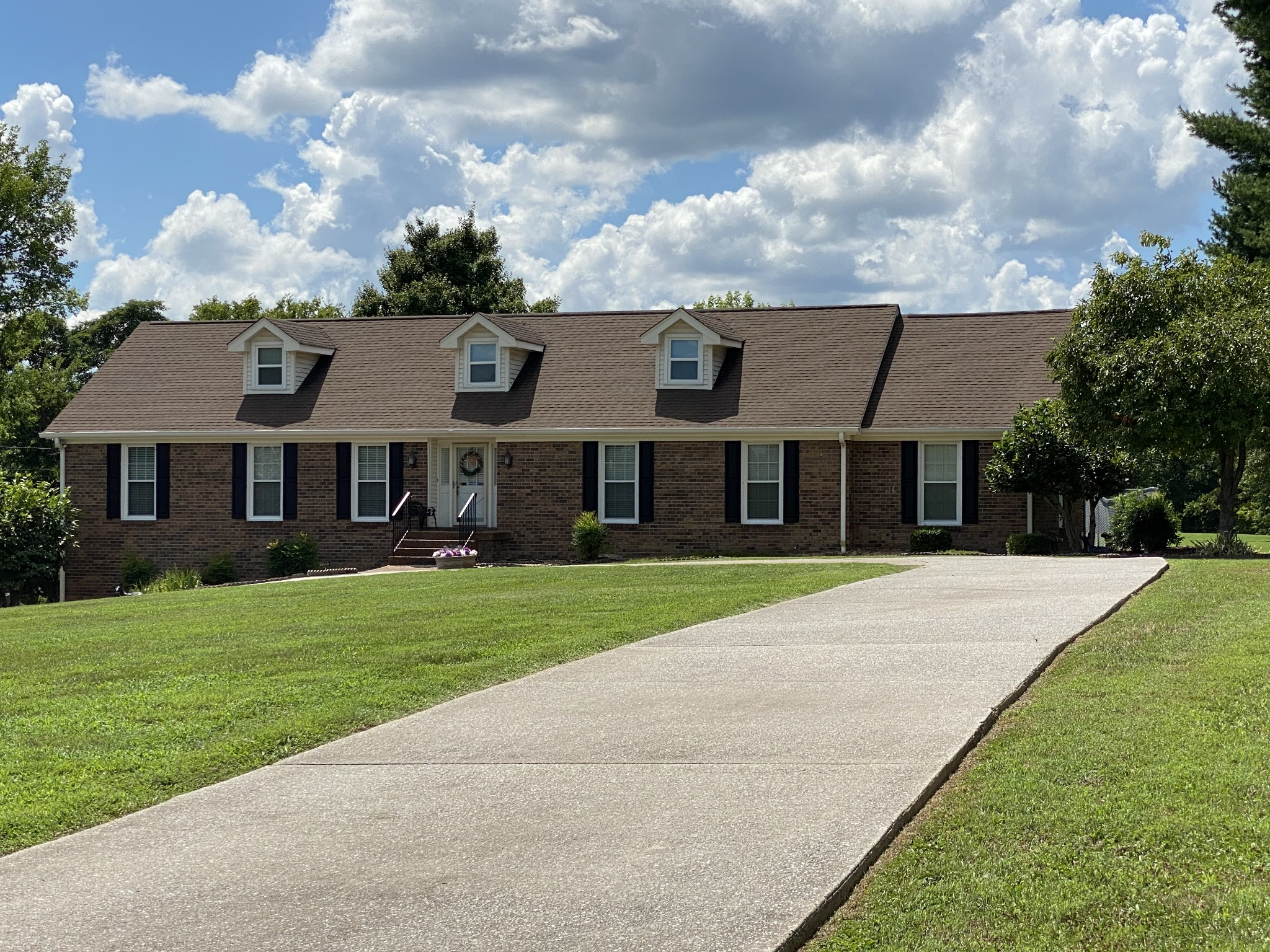 Here's a once in a lifetime chance!!  2600 SQFT home sitting on 3.95 acres close to the heart of Hendersonville.  Beautiful and scenic. 4 bd/2 full bath, full unfinished basement with garage.  1 owner home.  2 wood burning fire places. Partially fenced in back yard.  Deck.  Sun room. Custom closets in the master bedroom.  Spacious, open and yet very comfortable. Meticulously cared for.  City ordinances allows horses on this lot with some restrictions.. Close access to Stark Knob boat ramp