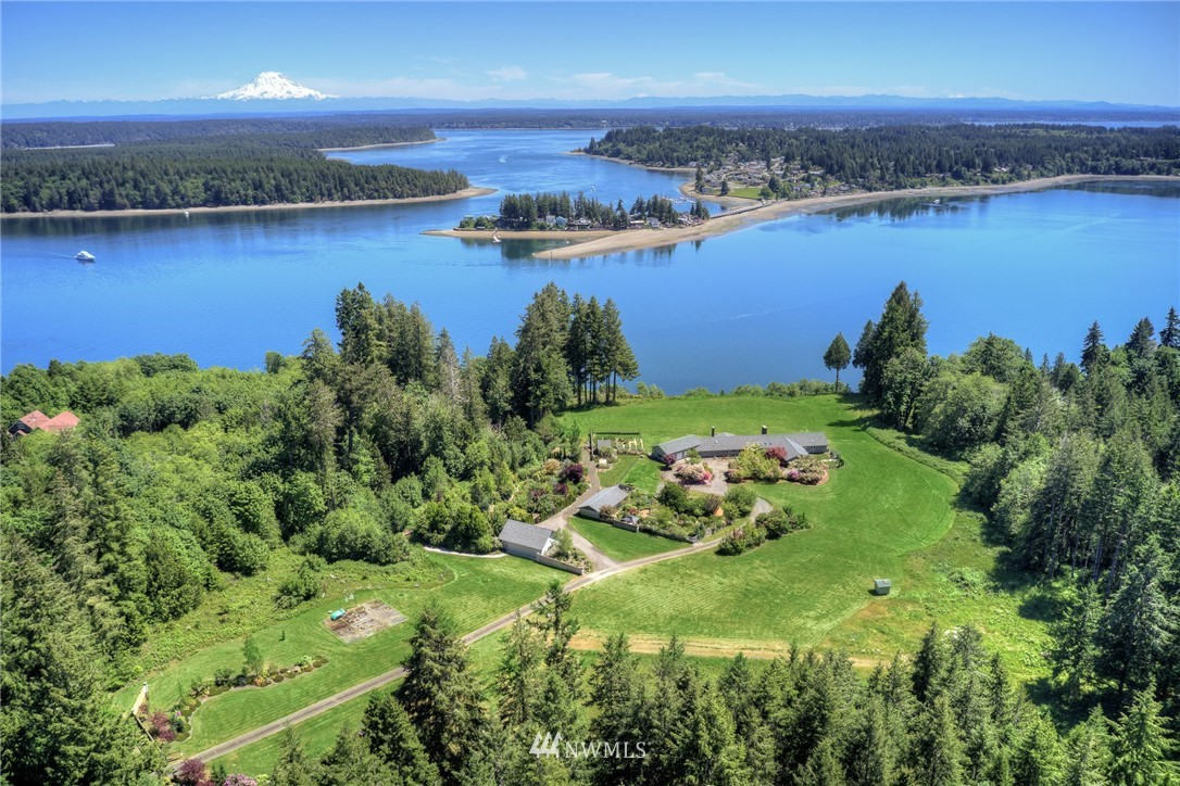 Stunning 31 acre South Puget Sound waterfront estate. 659 (+/-) feet of waterfront plus tidelands (+/-) on Totten Inlet. Stately 5,500+ sq. ft. one level home custom built by in 2016 Jordan Gritton takes full advantage of the spectacular views of Mt. Rainier, Totten Inlet, Steamboat Island, Hope Island and territory beyond. 3 bedrooms plus office, 4.5 bath home offers classic contemporary style architecture and is a timeless beauty. Long private gated driveway, detached garage designed to hold 26' boat, exquisite fenced park-like garden areas, sprawling pasture, timber and a prime Arcadia Point location.