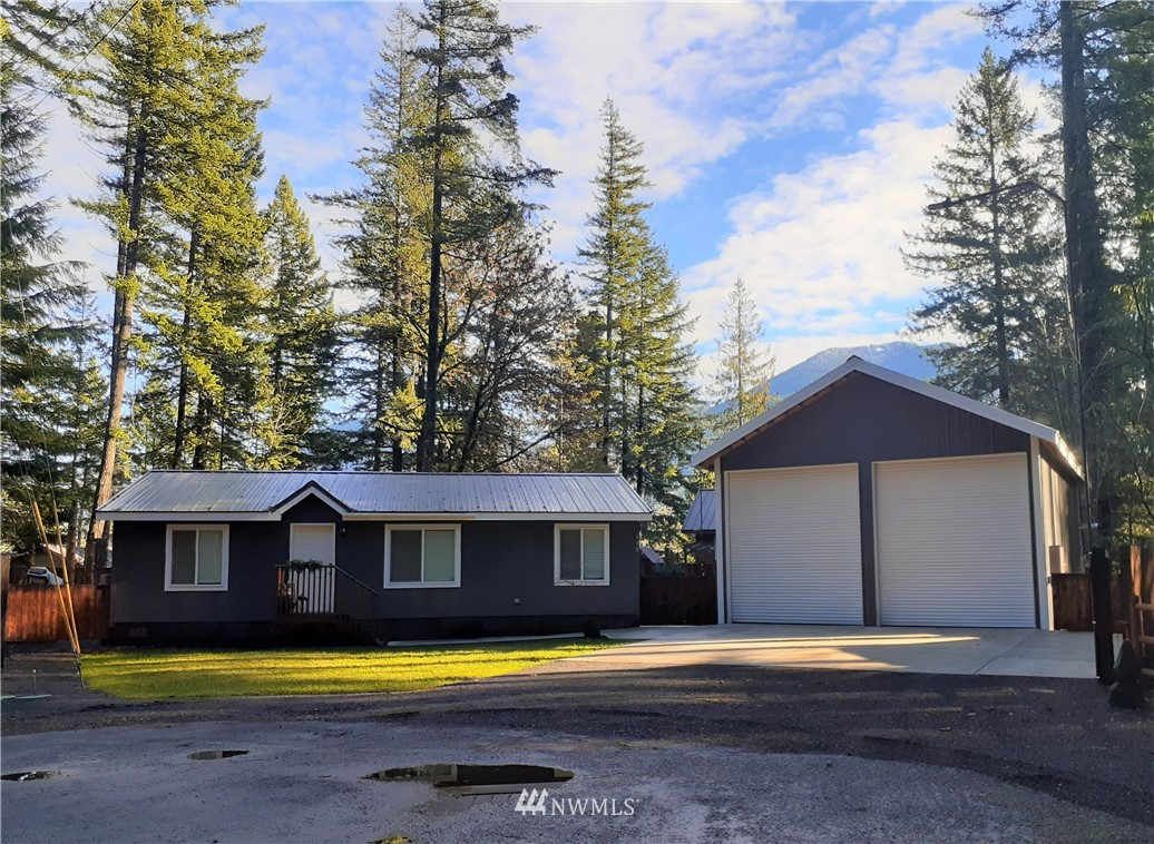 Lazy B is a warm & welcoming income producing turn-key vacation rental, with large 24 x 36 shop. 1,120 sq ft home w/ 2 bdrm + den/office, 2 bath, laundry and central forced air heat. Security cameras, digital lock and smart plugs. Yard is landscaped, fully fenced back yard with fenced garden space. Cozy up with friends around the fire pit and LED fountain. This is outdoors at it's best! Plenty of parking, with space for RV. Tesla Wall Connector. Home is wired for generator. Close to skiing, hiking, biking, fishing and more outdoor activities! High Valley amenities include a par 3, 9-hole golf course, outdoor pools, playground equipment, clubhouse and community water included with dues. See Broker Extra Remarks in Listing Attached Docs.