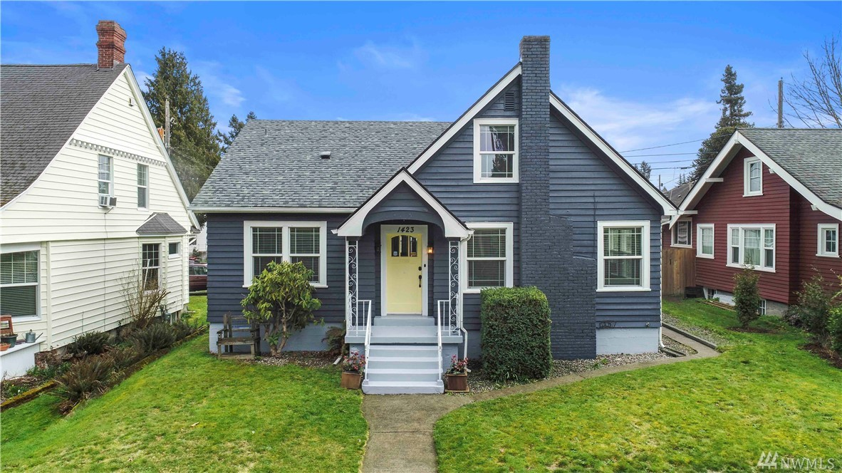 In desirable north Tacoma sits this charming 1927 Tudor. This spacious layout offers 5 bedrooms with lg living room, formal dining room, kitchen w/breakfast nook, & mudroom off the back. 3 bedrooms upstairs w/an ensuite bath & 2 beds with bonus or office on the main and a full bath. Old world charm intact with refinished oak floors, new roof, updated systems and ample storage throughout. Unfinished basement for future expansion. 1 car detached garage with alley access. Close to great amenities!