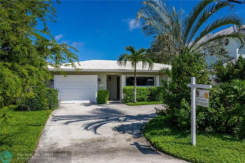 Waterfront home with no fixed bridges, minutes to Hillsboro Inlet. Take your boat out fishing, sailing or kayak up and down the canals. Quick bike ride to the beach. It's all there for your enjoyment. This home is located east of Federal Hwy. in a quiet family neighborhood. Remodeled 3 bedroom, or 2 bedroom w/office, split floor plan with 2 full, remodeled baths. Open floor plan w/travertine floors. Kitchen w/center island, living room, dining room & family room w/large sliders leading to deck. One car garage w/full sized washer/dryer, bike racks & work bench. 50' dock plus floating dock and depth for boat w/draft up to 5'. Large fenced back yard w/deck overlooking canal. Relax in your inground spa. Walk to Publix supermarket, restaurants & shopping. Minutes to I95 & public transportation.