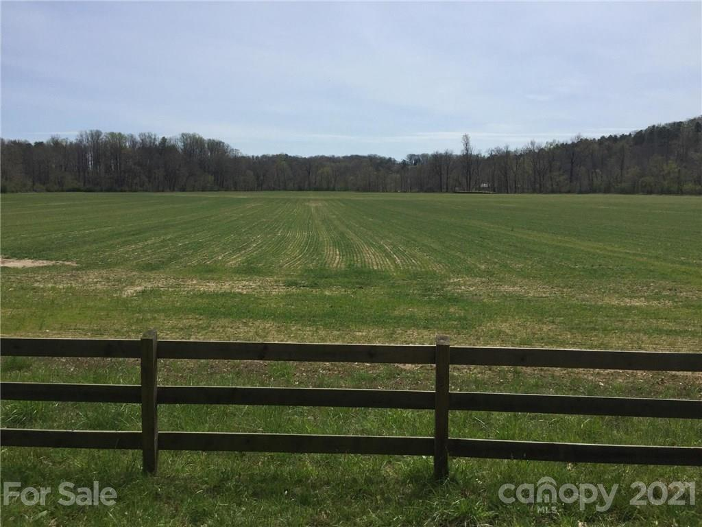 Beautiful 73+ acre Pacolet River riverfront tract of land just waiting for you to build your dream equestrian estate. See attached survey.  Beautiful Timothy/Fescue level pasture with 3 board fencing. Located in hunting country on the FETA trail system with equestrian trails within the property.  Just minutes to FENCE, Harmon Field and TIEC.  Road already in to the private bldg site on knoll with mountain and pasture views. Woods are abundant with wildlife. Parcel is surrounded by beautiful horse farms and friendly horsey neighbors. A portion of the property is in the flood plain.