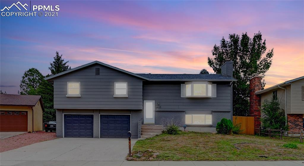 Fully renovated, turn-key home in sought after School District 20! Gorgeous 4 bed, 3 bath home with over 1,900 sq ft. Large, fully fenced yard with quick access to Academy Blvd, shopping, I-25, and other major thoroughfares. Renovations (most of which done within a year or less) include:  - Roof, water heater, 2018 furnace, newer windows and doors - Elegantly appointed kitchen including large center island, deep quartz countertops, stainless appliances, and brushed-gold finished hardware - Beautifully updated bathrooms. Master retreat includes modern hexagonal tile, gold accents, rainfall showerhead and floating vanity - Fresh paint inside and out - 'Hunter Douglas' top-down/bottom-up blinds on all windows, including master bedroom blackout treatments - 'Lifeproof' brand laminate flooring in kitchen and dining with new carpet throughout - New whole-house lighting updates including foyer pendant, recessed lighting, and bedroom ceiling fans - Large 'Trex' composite rear deck.