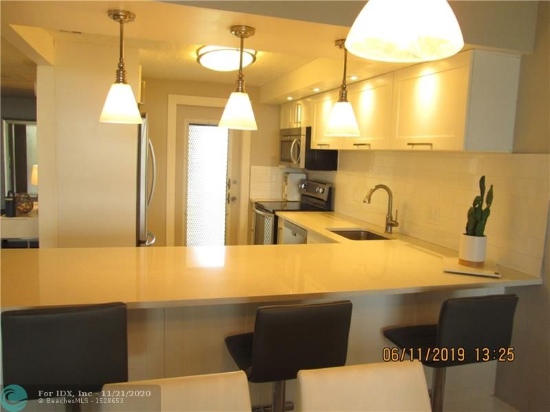 YOU WILL LOVE THIS CONDO THE MINUTE YOU WALK IN  - VERY MODERN AND  BRIGHT - COMPLETELY OPEN KITCHEN AREA LOOKING WEST WITH THE VIEW OF THE LAKES AND THE GREENERY OF THE GOLF COURSE - 3/2 CORNER UNIT ELEGANT & RENOVATED - ALL AGES WELCOME. WITH THE AMENITIES, YOU FIND A HEATED POOL,