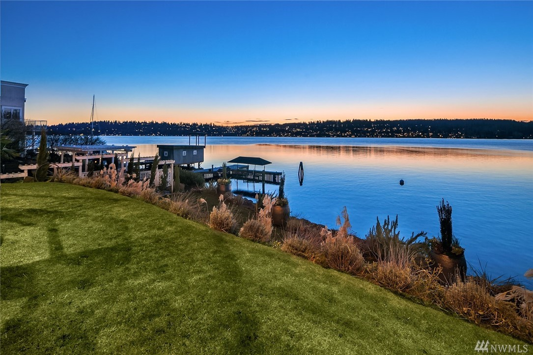 Custom 2013 built western facing waterfront masterpiece on Lake Washington. Main level features wide plank old growth fir floors, 10ft ceilings, chef's kitchen w/rare 12 burner double Viking Brigade oven, custom built copper hood & 10 ft butcher block island. Top level master suite includes private terrace & sitting room, master suite w/marble countertops, heated Ann Sacks tile floor/shower. Lower level full wet bar/wine room, views from all guest suites. Inglewood Country Club, 70 ft waterfront