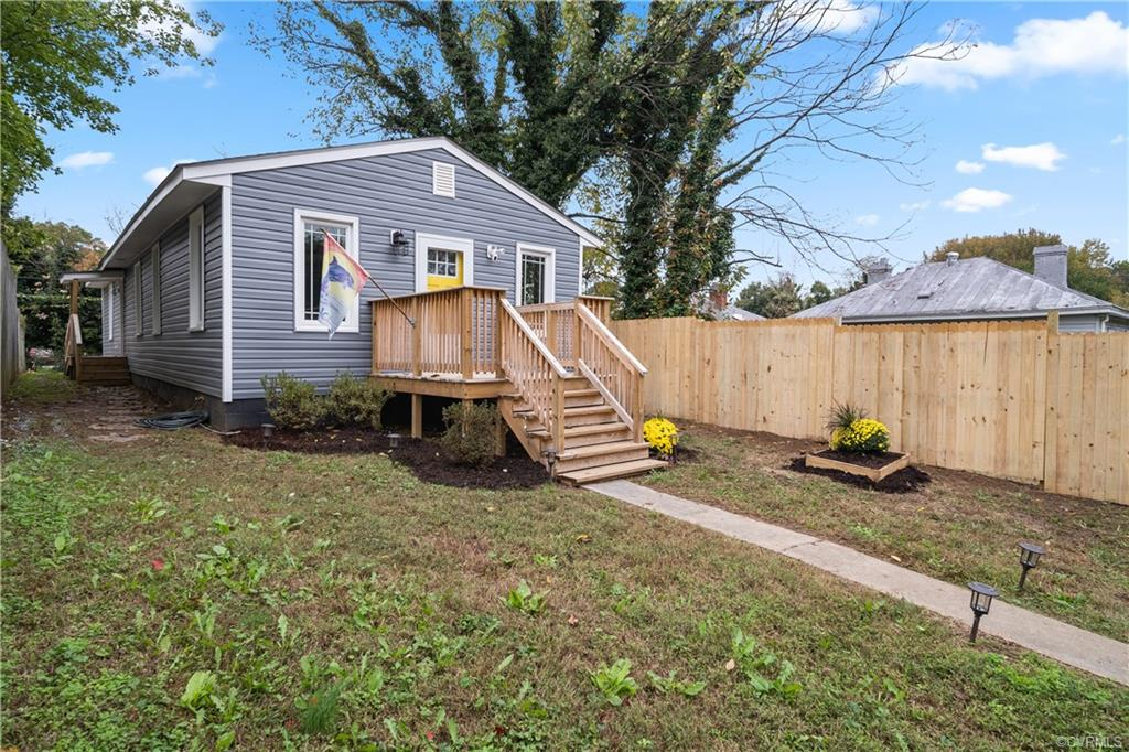 You are going to LOVE this beautifully renovated FOUR BEDROOM, 2 FULL BATHROOM, ranch style home. This home offers many updates including BRAND NEW Vinyl siding (2020), NEW Pella Vinyl energy efficient windows (2020), BRAND NEW 30 year ROOF, BRAND NEW HVAC system (2020), FRESH PAINT throughout (2020-Agreeable grey by sherwin williams), NEW KITCHEN CABINETS, NEW STAINLESS STEEL APPLIANCES, NEW GRANITE COUNTERTOPS, NEW LUXURY VINYL PLANK flooring throughout entire home, NEW light fixtures throughout and tons of recessed lighting and so much more. As you enter the home you are greeted with a large open living room completely open to the HUGE kitchen and dining area. Off of the kitchen you will find a large utility room with washer and dryer hookups. There are two bedrooms off of the living room and the Master suite is at the rear of the home along with the fourth bedroom. The master has a large closet and elaborate en suite master bath with custom tile work. The full bathrooms are fully renovated with tile flooring and floor to ceiling tiled showers. There is off street parking off of the alleyway with a freshly stoned driveway in the backyard and the property was just landscaped!