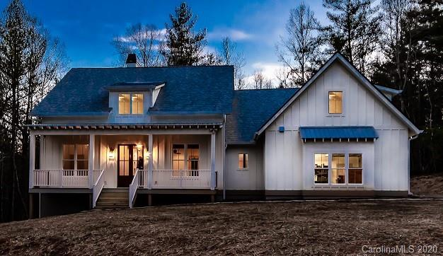 There's no shortage of curb appeal for this beautiful 3 bedrooms modern farmhouse plan. Fantastic lot in a small community in the Heart of Fairview. Only 5 minutes to Asheville, the Blue Ridge Parkway and the interstate. This lot is located at the end of the cul-de-sac and is perfect for a single-family home.  Underground utilities including city water and natural gas. The formal entry and dining room open into a large open living area with raised ceilings and brick accent wall.  The Lg kitchen has views to the rear porch and features an island with an eating bar as well as a large pantry.  The 3 bedrooms are well-sized and all include large walk-in closets.  As an extra feature, an upstairs bonus space is provided that would be perfect for a guest suite or that family game room. With so much to offer, make this your home today!