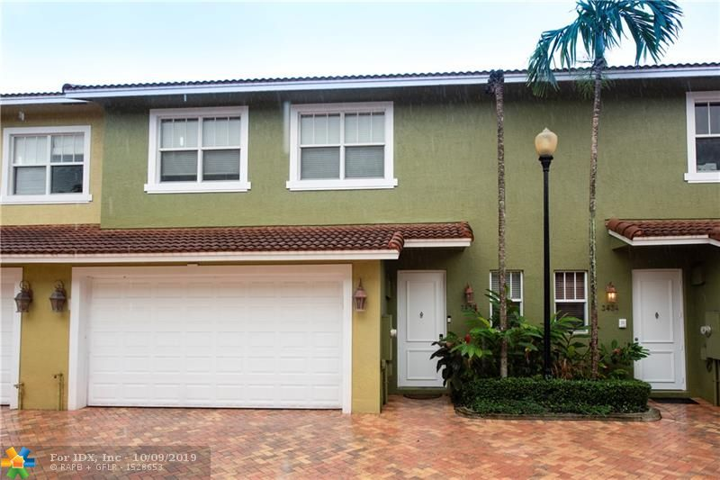"""Spacious 3 bed 2 bath townhome in downtown Oakland Park. 1st fl living area features french doors open to a fenced & paved courtyard w/lush tropical landscaping.  The 1st fl offers open floor plan, w/ a spacious living room/dining room, vaulted ceilings & crown molding plus Hunter Douglas window treatments thru out make this living space hard to beat. Kitchen has all granite counters, s/s appliances and 42"""" cherry wood cabinets. The master bedroom is very spacious with a lovely Juliet Balcony. The en suite bathroom features a separate tub, shower & dual sinks. All windows & doors are hurricane impact, the 2 car garage features a hurricane rated garage door. This home is tucked away in a lovely 8 unit complex w/fenced private community pool. Close to I95, walk to Wilton Dr to shop & dine."""