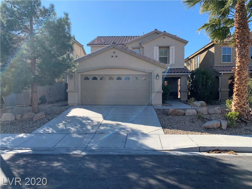 Beautiful home in the Master Planned Aliante Community. Open floor plan with Tile on first floor, and wood and carpet on second floor level. Kiechen has Granite countertops, and tile floors. Large Master Suite. Nice backyard with patio.