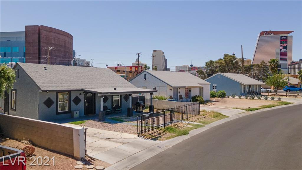 Check out this unique property close to downtown!  Single family residence w/casita!  Owner has modified to create 3 units.  Sit in your front yard and enjoy lights from Circa & the DT casinos or walk to them for FUN! Renovated color scheme is consistent t/o, all have granite countertops, gray cabinets, new flooring & fixtures, tile-surround showers & all appliances including fans & w/d. Two bdrms have walk-in closets.  Long driveway w/pkg in the rear, front & back patios, cable & Internet ready! Outside yard has an RV gate, a side yard dog-run,  Container storage unit and a Parcel drop for tenant convenience.  This place is awesome...looks good and a great location!  Surrounded by homes that have been remodeled; it's cute, quaint area!  ***casita has a separate entrance; and, tax records state a carport; hasn't been there for years.