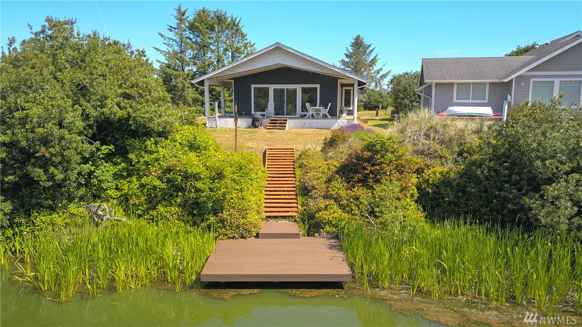 Beautiful house on the waterfront in a quiet location with dock installed. This house has a great floor plan with two beautiful bathrooms and a light/bright kitchen. The home features a fireplace, vaulted ceilings, covered outdoor seating, and close proximity to the local ocean beaches. Enjoy boating, fishing, swimming, surfing, and clam digging at your new Ocean Shores home.