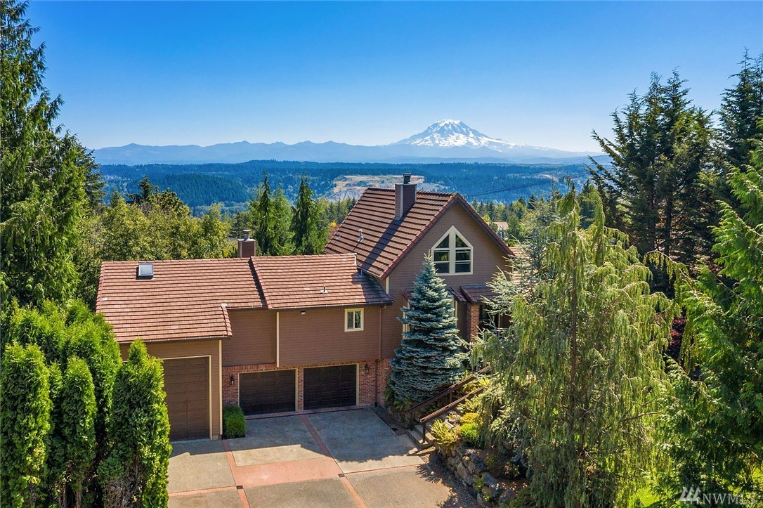 NW architecture at it's finest with majestic Mt. Rainier & Valley views that make you want to exhale! Beautiful Brazilian cherrywood floors, stone fireplace & incredible floor to ceiling line-up of windows to soak up the view! Cherrywood cabinetry, incl blt in china hutch, wine rack & walk-in pantry complete this gorgeous kitchen. Main floor owner's suite has slider to deck, see thru fpl backing to tub in ensuite bath. Extensive new decking. Deep 2+Garage+3rd RV bay 39x14. Tile roof, heat pump.