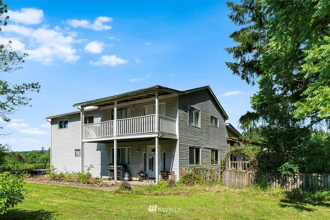 Want to get away from the hustle and bustle? This large farm house on 10.86 fenced acres and two tax parcels is waiting for you! Located on a quiet dead end road just out side the quaint community of Onalaska and close to world class Cowlitz River fishing. Perfect spot to make all of your self sufficiency dreams come true! This home features 4+ bedrooms, newer open kitchen, sliding glass doors to the deck, and to a balcony off the master with a view of the secluded yard. You'll find tile work in the kitchens and bathrooms, a cozy fireplace in the living room, a large walk in pantry, and many more wonderful features! Attached 3 bay garage, circular driveway, covered RV parking, and a barn help complete the property.