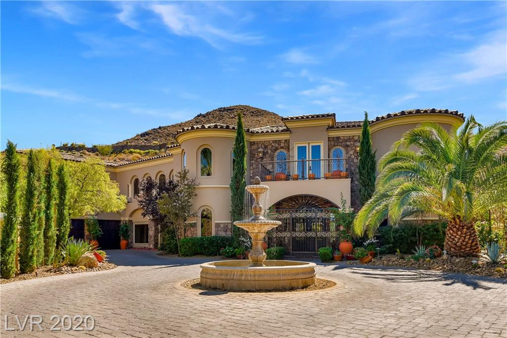 "This beautiful Tuscan estate with a resort style backyard is tucked inside a quiet cul-de-sac in the exclusive guard-gated community of SouthShore Country Club in Lake Las Vegas. With over 100k in upgrades, including front and backyard Tuscan style landscaping with beautiful Italian Cyprus trees, and an iron gate at the front doorway entrance. Featuring 4 bedrooms, including 3 private master suites, one on the first-floor, each with en-suites, walk-in closets and living areas. The loft style theatre room features a wet bar and includes a top of the line Sony 85"" 4K UHD TV and Klipsch Surround Sound speakers for the ultimate movie night. The chef style kitchen includes professional Viking stainless steel appliances and plenty of storage and counter space. The private resort style backyard oasis features a lagoon-style pool with cascading waterfall and spa, an outdoor kitchen/lounge area, fireplace and vegetable/herb garden. Mountain, golf course and lake views from the balconies."