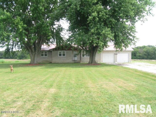 Country living with this well kept stone house with a full basement. This home has 3 bedroom & 1 bath with the possibility of another bathroom in the basement. The home has newer superior windows & a newer metal roof. There is a 50X65 barn on just under 2 acres with additional 5 acres possible.