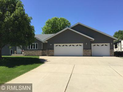Custom built one owner 4-level home nestled on a large city lot.  Maintenance fee exterior with brick accents.  In-ground irrigation system with private water supply.  New vinyl plank floor coverings in kitchen dinning areas, Lower level bath, and new stainless steel appliances.