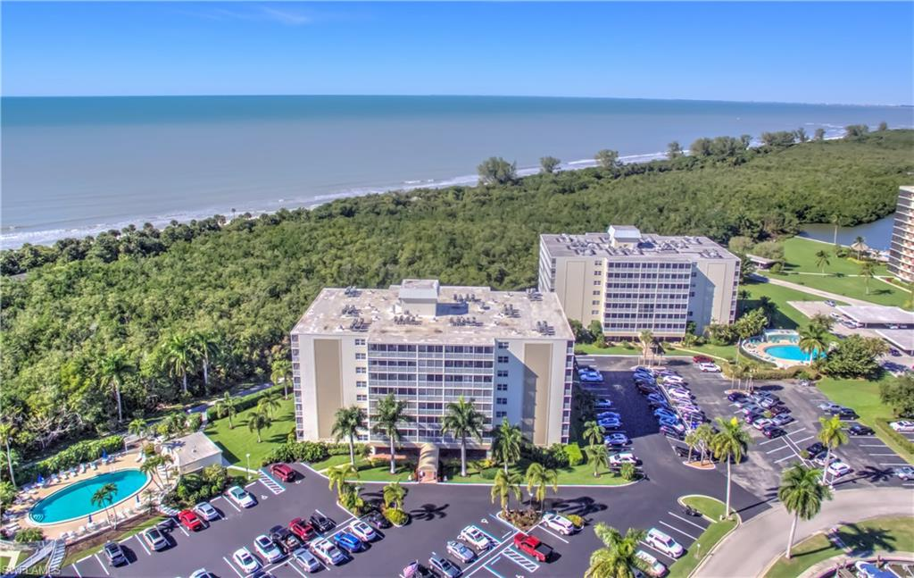 Spectacular GULF VIEWS and SUNSETS from every room in this stunning coastal chic remodeled 1 bedroom condo. This unit has it all, tile floors, quartz counters, white high end cabinets, stainless appliances and impact sliders for your piece of mind while away. This community is only steps to one of the worlds finest beaches, a great pool, boat dock (For Lease) and an in house community room to meet new friends. As if this isn't enough the Ritz, Mercato, Trader Joe's, Whole Foods and an almost endless amount of entertainment and shopping venues are only minutes away.