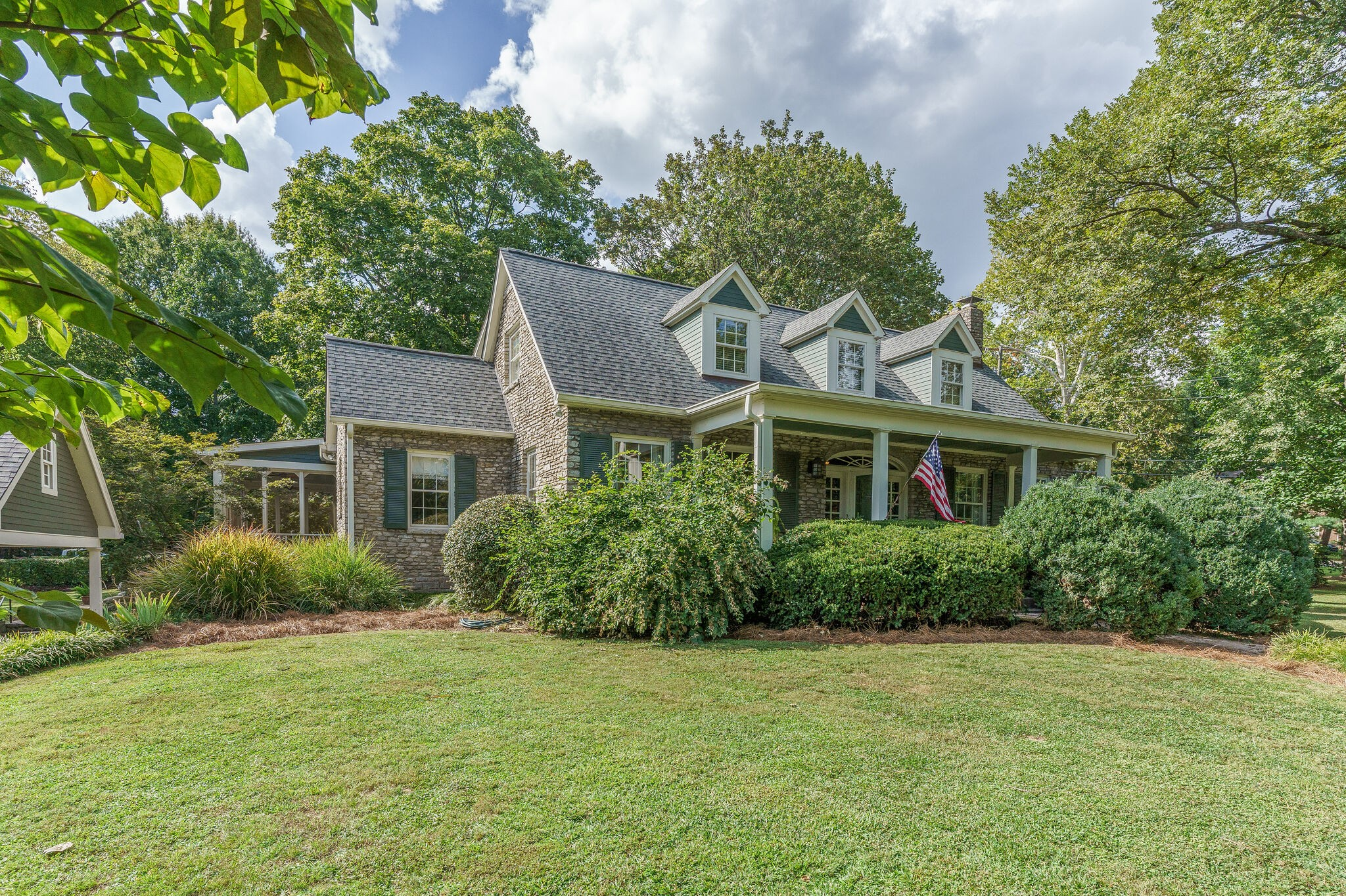 Beautiful stone Cape loaded with charm and character.  Fabulous open kitchen with large family room addition.  Hardwoods throughout, 3 FP's, 9' ceilings down. Office off living room,. Great flow for entertaining. 3-car carport w/overhead storage. Screened porch with removable screen panels.   Large corner lot with mature landscaping.  Great location!  Showings begin Sun,.Sept. 19 at 1:00. p.m.- Offers reviewed Fri., Sept. 24, at 4:00 p.m.