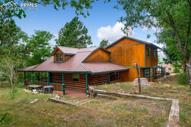 "Amazing 30 Acre Property!  Property Has A 2,655 Sq. Ft. Home, Arena, Pavilion, Hay Barn, Stall Barn w/Tack Room & 6 Car Garage, 1 Is RV! More Descriptions in Supplemental. Main Level Enjoys Hardwood Floor In Living Rm, Family & Kitchen! Living Rm Has A Pellet Stove! Spacious Kitchen Enjoys A 64 x 71"" Refrigerator/Freezer, Center Island & Lots Of Cabinets! Main Level Laundry & Master w/Adj. Master Bath, Wood Beamed Ceiling & Bay Window! 2 Other Bedrooms On Main, 2 Upstairs, 1 Has Balcony! Deck Wraps Most Of Home w/Railing! 30 Acre Horse Property, Fenced & Cross Fenced! 2 Story Home with 5 Bed, 2 Bath. Huge Enclosed 200 X 250 Arena with 32 Stalls & Round Pen! Pavilion Used For Special Events 40 x 94, 60 x 36 8 Stall Barn with Tack Room, 2 Detached Side by Side Garages 50 x 45 & 40 x 30 With RV Door.  100 x 120 Outdoor Arena. This Property Was Intended To Be Used For A Therapy Center But Has Many Possibilities!"