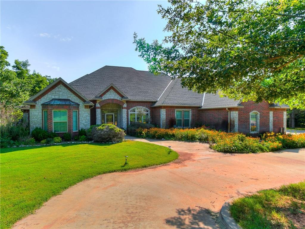 What a great home in a wonderful neighborhood!!! Walk out your back door to have coffee under your covered patio or have it on your huge backyard deck to soak in the sun. After coffee, step outside your fenced yard to walk around the pond on the trail maintained by the HOA or go to the public dock to fish. This home has a lot to offer outside & inside. It has an open floor plan with the kitchen & eating area open to the living area. The kitchen has double ovens, trash compactor, mobile island & a ton of cabinets & countertop space. The main living is large but it's a very cozy area with a fireplace and a wall of cabinets & shelves. The office has access to a 1/2 bath & garage. The bonus room upstairs could be a movie room or hobby/craft room. There is a bedroom w/ a full bath on the opposite side of the house from the master & other 2 bedrooms. Perfect for MIL or college kid. 2 new HVAC units, new pump & pressure tank for the well in 2020, seller says all reasonable offers considered.