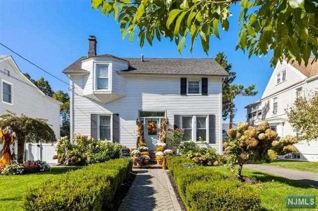 Welcome Home to this beautiful Center Hall Colonial in the Borough of Trees, desirable Rutherford. This spectacular home is situated on an oversized lot on the west end of town. It has been renovated in 2016, the main living space features a living room, updated kitchen, that flows nicely into the formal dining room or large family room that overlooks into the back yard. There are three bedrooms, PLUS a Master Suite with master bath and full bath on second floor. Hardwood and ceramic floors throughout. Finished walkout basement and full bath are in the lower level. Inviting backyard with semi in ground heated pool, ready for entertaining. Two car detach garage. Commuting into NYC via NJ Transit or jitney to train station is near. Major thoroughfares... Route 21, 17, 3, GSP and NJT. Definitely a must see!