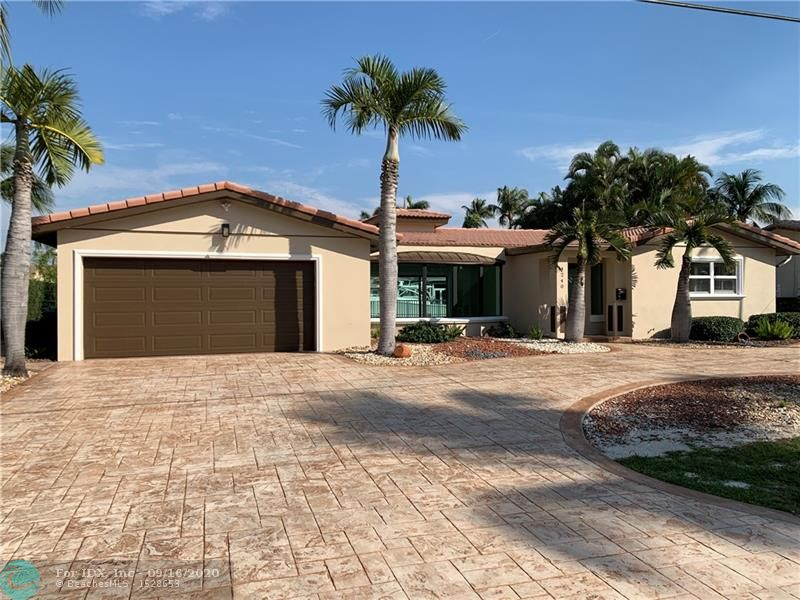 Totally redesigned and remodeled Venetian Isles East exposure home on 85-ft of deepwater. With 3 bedrooms and 2 baths, this home has an open floor plan, a split bedroom plan, updated kitchen and baths, all impact glass,2 car garage, 2017 A/C, new water heater,  large pool/patio area, brand new dock with concrete pilings, and is vacant and easy to show.
