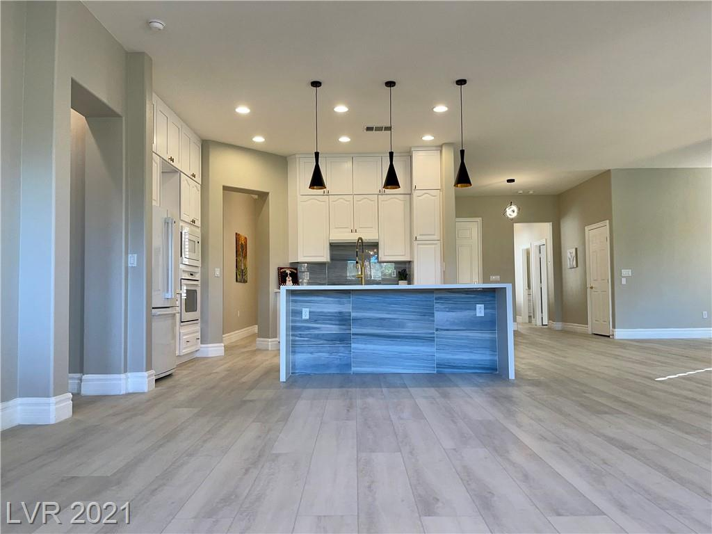 View! View! View, one story home on the golf course in Rhodes Ranch guard gated community.  Once you open the front door the golf course is in front of you,  newly remodeled, you will fall in love with this home.