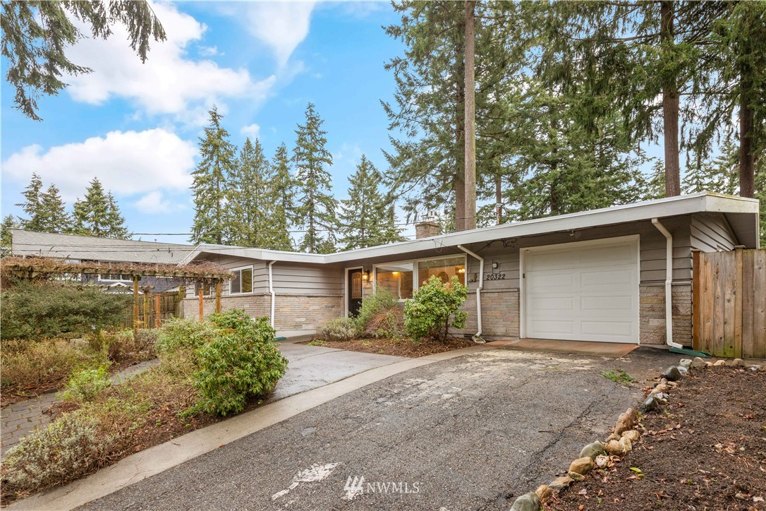 """Welcome to this true Mid Century Modern Beauty! Turn key ready! This well cared for home is an absolute delight! Lovely entrance into a vaulted ceiling living rm/dining rm w/access to the outdoors. New flooring in kit, & lovely hardwoods within all the living areas, including 3 large bedrooms. Roomy master bedroom w/ walk in closet, full ba, & slider to patio for morning sun w/ coffee. Fantastic outdoor spaces for gardening, entertaining and solitude. An English garden look in the front yard w/mature flowering vines on the arbor. This home is in terrific condition! Fenced yard w/ """"The Gate Lever' for easy access on both gates! Something you'll love! Make this lovely home yours!"""