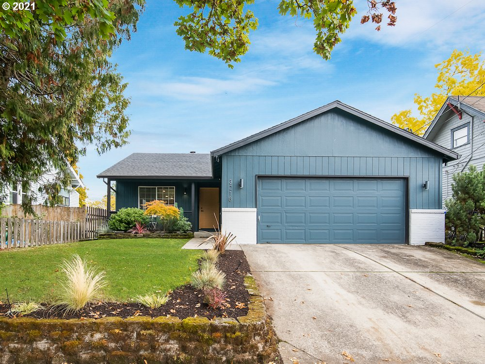 Sleek Roseway one-level, smartly updated with style and comfort in mind. This home has awesome flow! Large windows & vaulted ceilings capture all that natural light. Centrepiece gas fireplace, and stunning remodeled kitchen with eat bar, lovely tile, stainless steel appliances. Spacious primary bedroom & ensuite. Two more bedrooms and a second bath make working from home a breeze. A/C, 2-car attached garage, private deck and yard, and great location near Sandy Blvd., shops, transit, and more! [Home Energy Score = 7. HES Report at https://rpt.greenbuildingregistry.com/hes/OR10196046]