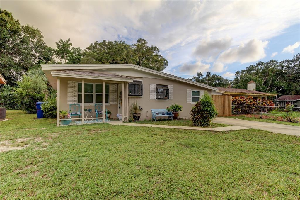 Come visit this super adorable beach cottage minutes away from the beach!! The sweet, inviting porch welcomes you into a home completely move-in ready. The living room provides ample space to lounge and entertain guests. The kitchen is completely functional with matching appliances and ample counter space. The family room with its beautiful fireplace is another great entertaining area and roomy enough for an intimate dining room. Both bedrooms are bright and airy welcoming in good vibes and fond memories. It is close to the beaches, airports, golf courses, shopping and delicious eateries. Are you looking to downsize near the beach? Or to start roots in a home with a fenced in backyard and plans to build a pool later? This home is perfectly ready for you to move in! AC 2021 Roof 2019. Come see this home today!