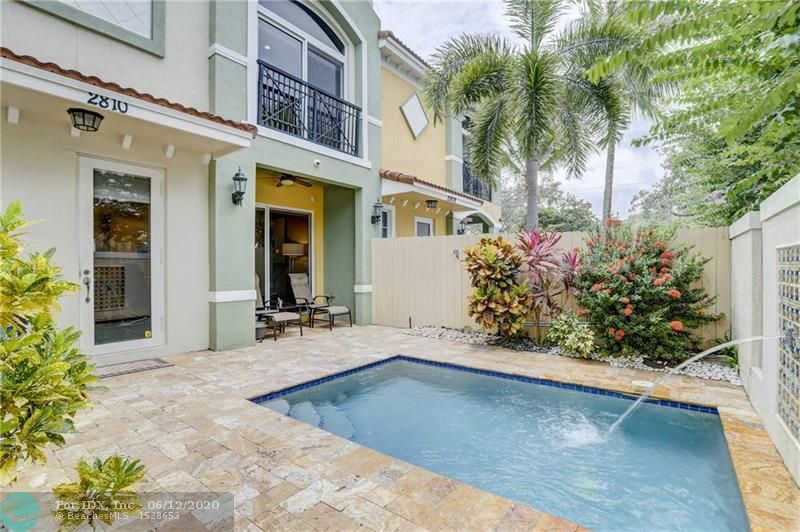 Live the South Florida lifestyle from this fabulous Ft. Lauderdale location just 1/2 mile from the beach and walking distance to some of the best restaurants in town. This gorgeous 3 bedroom, 2 1/2 bath completely updated townhome has beautiful porcelain & wood floors. Enjoy the open living space w/access to the courtyard & a gourmet kitchen w/upgraded backsplash, contemporary countertops and high-end appliances. The master bedroom contains 3 closets with 1 walk-in. Beautiful decorator touches throughout, crown moldings, ceiling fans & all closets have built-ins. All bedrooms and laundry room are upstairs.  Relax in your very own private courtyard with travertine pavers and saltwater pool. Never worry about putting up shutters as all the windows and doors are impact glass. Near Las Olas.