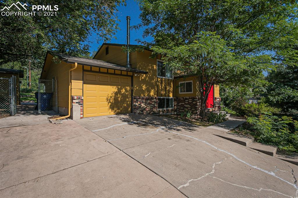 Welcome to this beautiful West Side home located just minutes from Old Colorado City and Garden of the Gods park! Spacious and bright living room ~ Large eat-in kitchen with plenty of cabinet and counter space has newer stainless appliances, ceramic tile flooring and walks out to the deck ~ Master bedroom with a walk-in closet, second bedroom and a full bath complete the upper level ~ Lower level offers a large family room with a dry bar, 2 more bedrooms and a 3/4 bath, and a large laundry room with storage space ~ Spacious deck, concrete patio area with basketball hoop helps you enjoy the outdoors ~ Newer roof (2016), newer hot water heater (2019), newer carpet and paint (2019), newer kitchen appliances (2019), newer washer and dryer (5/2020) and many more updates! ~ R-2 Zoning could offer many possibilities!