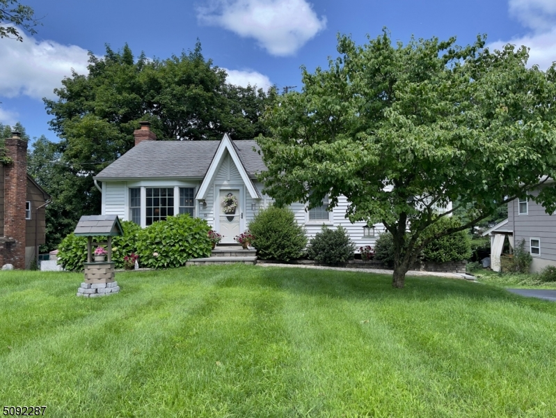 Welcome to this charming 3 bedroom 1.5 bath ranch with finished lower level. Open floor plan, tons of updates and hardwood floors throughout. Renovated kitchen with granite countertops and stainless steel appliances. Cozy living room and formal dining room, perfect for entertaining. Three nicely sized bedrooms and updated full bathroom complete this level.  Amazing lower level family room with wood-burning fireplace, playroom, and powder room. Sliding glass doors leading to a spacious yard and updated deck, ready to enjoy for gatherings.