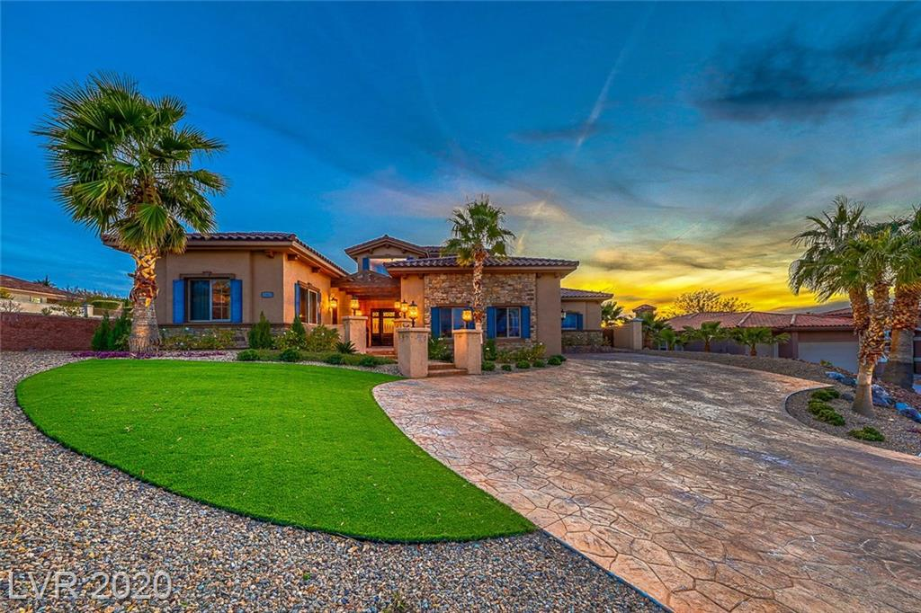Stunning Custom Home in prestigious South Shore of Lake Las Vegas. Architectural combination of elegance & style.Grand entry foyer ushers to open floor plan w/cathedral ceilings.Living room boast picture windows & bar w/wine room.Gourmet kitchen w/granite counters, custom cabinetry & stainless steel appliances.Master w/fireplace, backyard access & spa inspired bath.Casita w/en suite.Backyard oasis w/covered patio pool,spa located on the 7th hole.