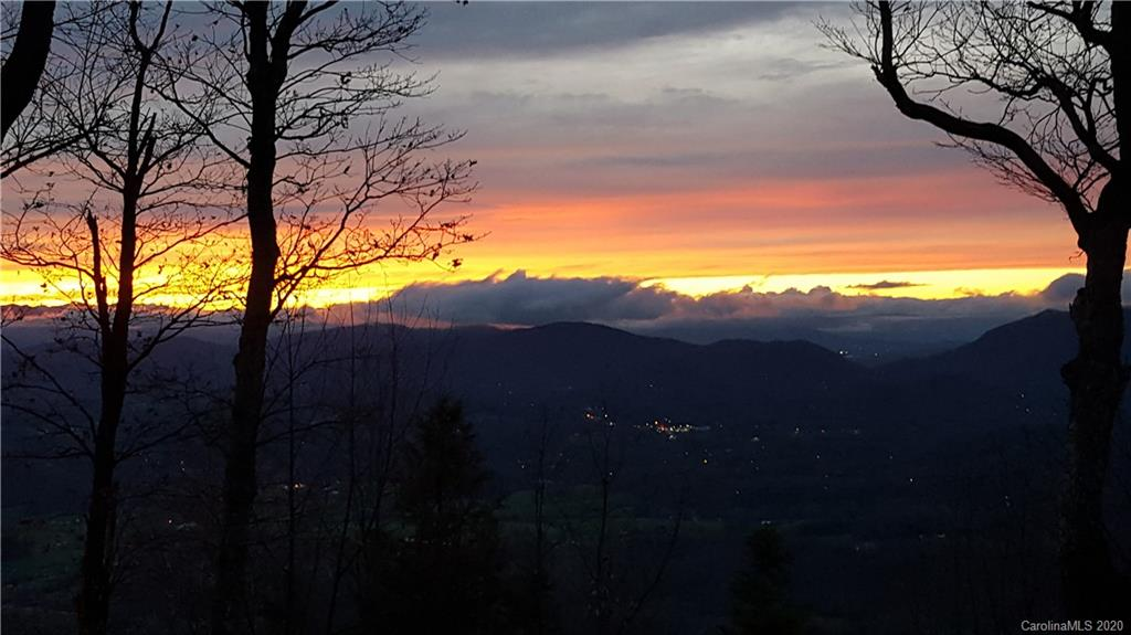 Views! Views! Views! If privacy and views are what your looking for this is your dream property.  Watch the breathtaking sunsets from your new home.  Incredible 180-degree views of Huge valleys and mountains from Pisgah to Mitchell plus long-range views to the Great Smokies.  Driveway cut in and house site cleared and ready for you to build your dream home. Cool rock outcropping on this property. This property is located in an overlay district.