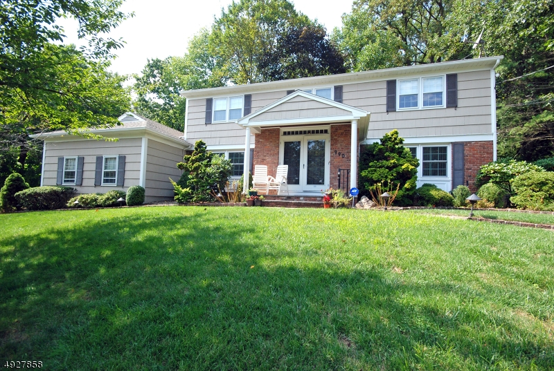 This spacious Colonial awaits you at a private & quiet location at the top of town on a cul de sac street. The large family/living room combination w/ gas fireplace, is perfect for entertaining. The designer kitchen has granite counter tops, double convection ovens & convenient pull out cabinets.  The dining room & family room both have entire walls of buiilt-ins for display & storage.  There are sliders in the kitchen & family room which lead to a huge, private rear deck. The master suite offers built-ins w/ a dressing table, multiple custom closets & an updated bath.  The fully finished basement offers an add'l office, full bath, rec room & storage rooms. Newer windows & roof, 3 zone heat, 2 furnaces, upgraded electric & surround sound. School bus stops in front of home & professional landscaping too!