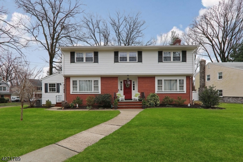 Spacious four bedroom Colonial near award-winning Downtown Cranford, parks, and Walnut/Livingston schools! The 1st floor features a charming formal dining room, eat-in kitchen, family room (w/ laundry), den, and large living room with fireplace. Upstairs, there are four bedrooms, all with great closet space. The large master boasts double closets and an updated full bath. Ample basement is partially finished and has a rec room, office, utilities, and storage room. Generous corner property has 2 car garage and secluded back patio. New boiler installed in 2014. Powder room and master bath updated in 2015. Upgraded electric and 2-Zone Central AC added in 2018.  Minutes to NYC train, yoga, library, restaurants, and more!